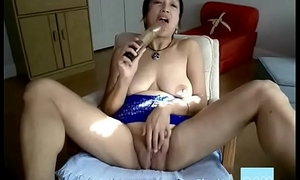 Horny Asian granny bonks herself with a dildo