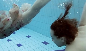 Two hot hairy cuties submersed