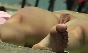 Nice shaved cunt uncovered females beach voyeur establish discontinue camera