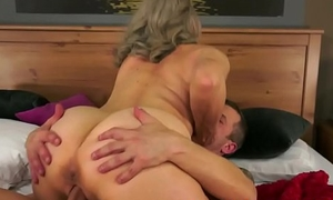 Bosomy granny drilled by her young darling